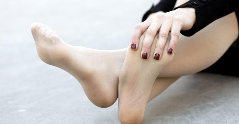 Woman rubbing tired feet