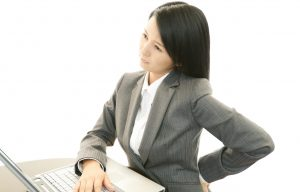 Tired young Asian business woman