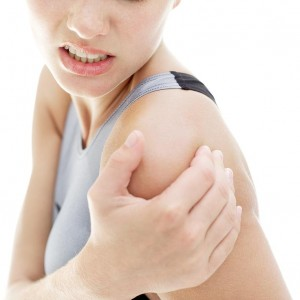 young woman shoulder in pain