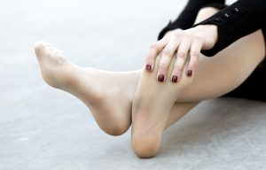Woman rubbing tired feet