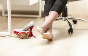 photo of female feet in ballet in office