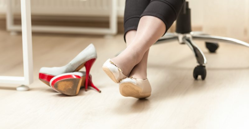 photo of female feet in ballet in office