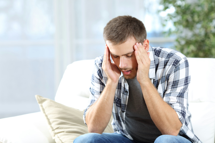 Man suffering headache at home