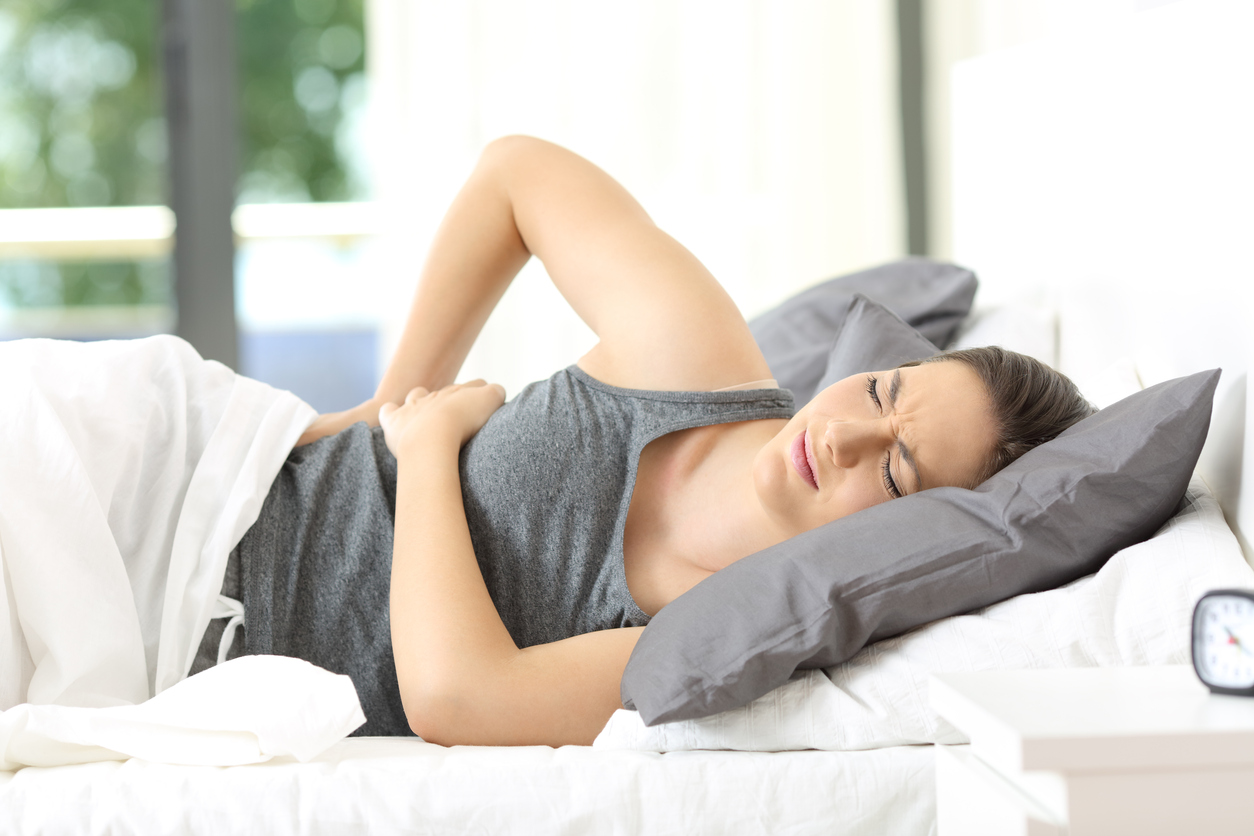 Woman waking up suffering back ache