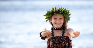 Pretty Girl smiling and dancing the Hula