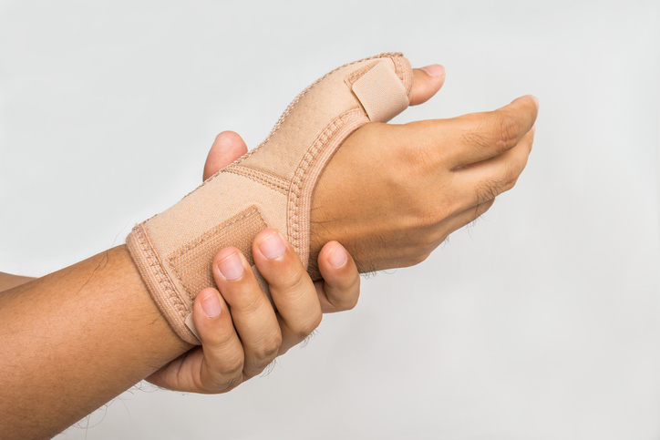 Injury hand with wrist supporter
