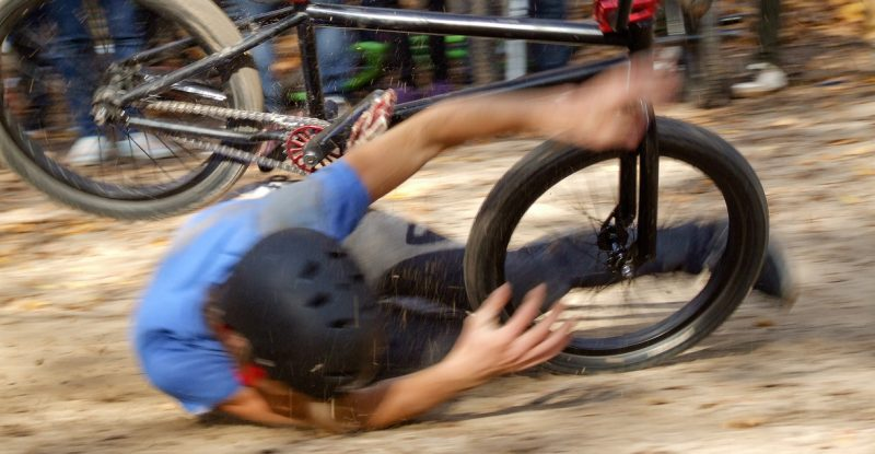 Man falling Off BMX Bike on Track