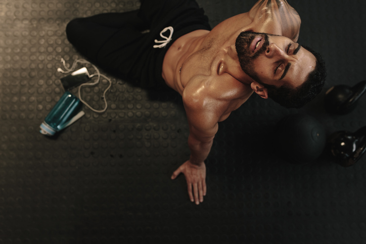 Male relaxing after workout session at gym