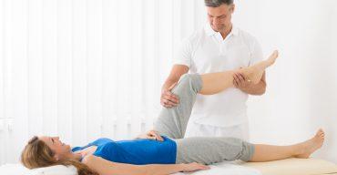 Woman Receiving Leg Massage In Spa