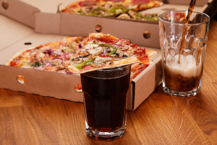 Glass of coke and pizza