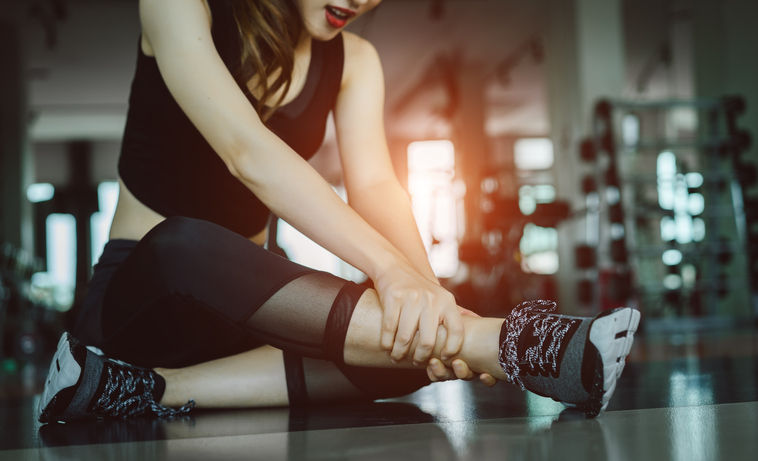 Woman doing sport exercise injury leg accident at gym fitness