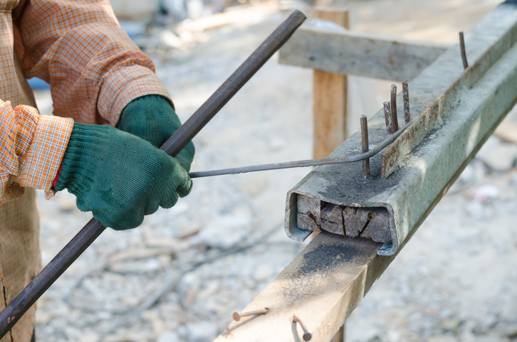 Labor hand bending reinforcement steel at construction