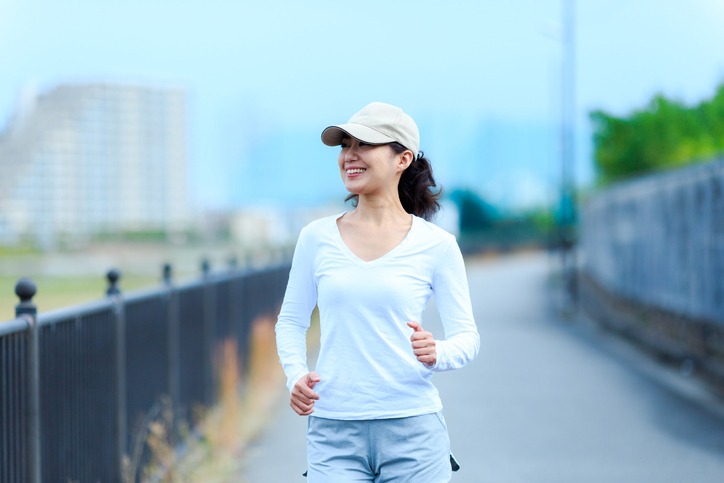 healthy woman walking outdoors
