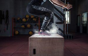 Box jump workout at gym gym closeup